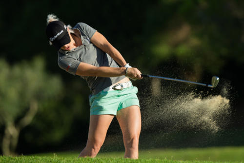 Melissa Reid of England plays out of a bunker on the 6th hol